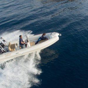 Photo of couple on motor boat on sea